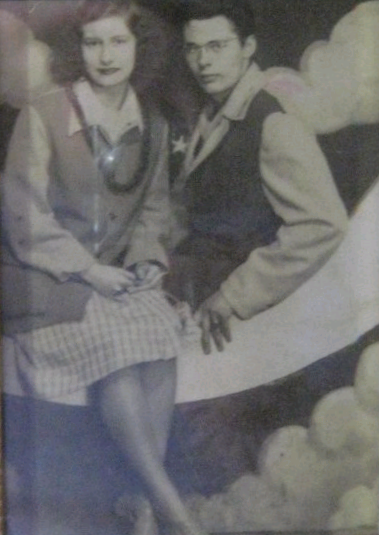 Patty's father, Edward Heyden, is pictured with her mother, sitting on the moon at the old Riverview Park in Chicago while they were dating. She is 16 and he is 18 in the picture, just before he entered the war.