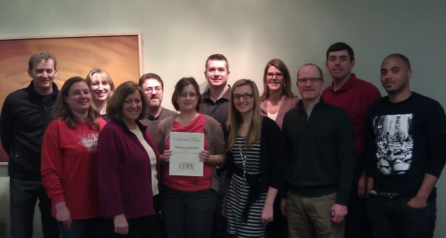 Our Eppy Award, along with just a few of the folks who make up the Legacy.com team.